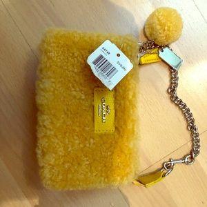 Coach fuzzy yellow small kids wristlet